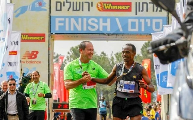 Mayor Nir Barkat with 2016 Jerusalem marathon winner Tadesa Dabi from Ethiopia