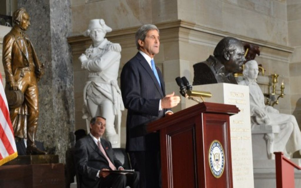U.S. Secretary of State John Kerry delivers remarks at the dedication of a bust of Winston Churchill at the U.S. Capitol in Washington, D.C., on October 30, 2013. The bust is being placed pursuant to H. Res. 497, which was authored by House Speaker John Boehner and passed the House shortly before the 70th anniversary of Churchill's wartime address to a joint meeting of Congress.