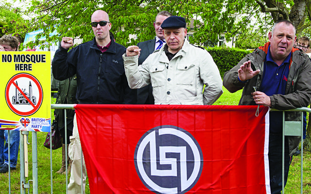 Piers Mellor [left] and Eddie Stampton [centre] from neo-Nazi group New Dawn  were behind a planned neo-Nazi march in Golders Green