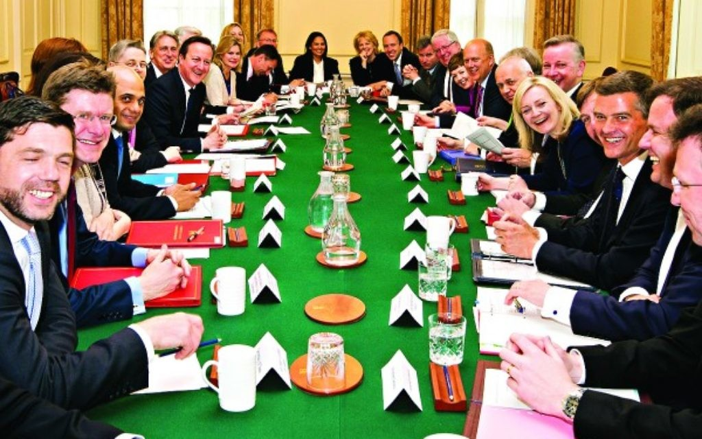 Prime Minister David Cameron hosts the first cabinet meeting with his new cabinet in Downing Street in London, following his General Election victory.