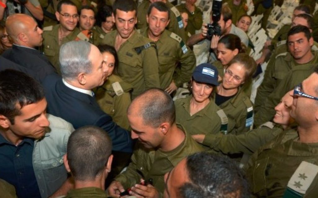 """Photo by  Haim Zach/GPO/Israel Sun 12-05-2015 PLEASE CREDIT Haim Zach/GPO ONLY  Prime Minister Benajamin Netanyahu greeted the returning IDF Nepal delegation on Tuesday morning at Ben-Gurion Airport just after another strong earthquake shook the devastated Himalayan country.  Netanyahu spoke of the accomplishments of the delegation. """"You helped 1,600 wounded people and brought new life with at least eight births. You have shown the true face of Israel- a country that values life."""""""