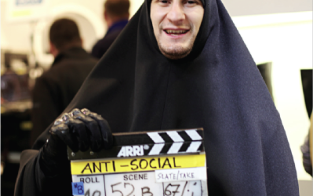 Dressed for work: Josh Myers disguised as a gang member in a burka on the set of his latest film, Anti-Social
