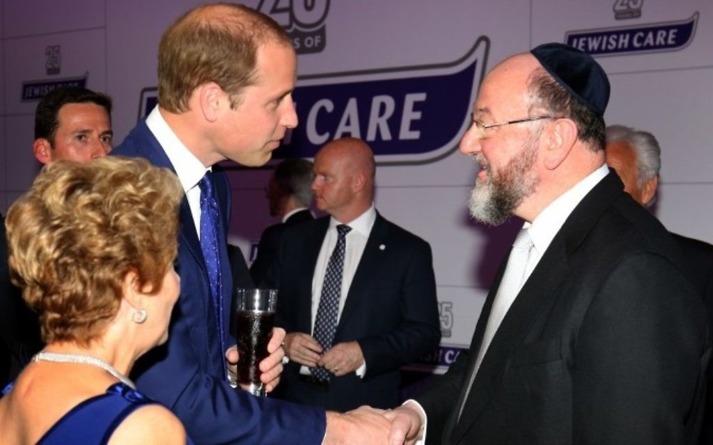 The Duke of Cambridge meets Chief Rabbi Ephraim Mirvis (right) as he attends the 25th anniversary celebrations of Jewish Care at Alexandra Palace, London. PRESS ASSOCIATION Photo. Picture date: Thursday June 11, 2015. The organisation provides care and support to 7,000 members of the Jewish community and their families each week, meeting the needs of a range of groups from Holocaust survivors and those with mental health issues to carers and others with degenerative illnesses. At the heart of the charity's care provision are 11 residential care homes, six community and day centres and three specialist centres for people living with dementia. Jewish Care was created in 1990 through the merger of two charities and today has 1,500 staff and 3,000 volunteers. The organisation also provides social and recreational programmes for people of all ages. Its youth leadership programme also gives young people the opportunity to develop their leadership skills whilst volunteering in the community. See PA story ROYAL William. Photo credit should read: Chris Radburn/PA Wire