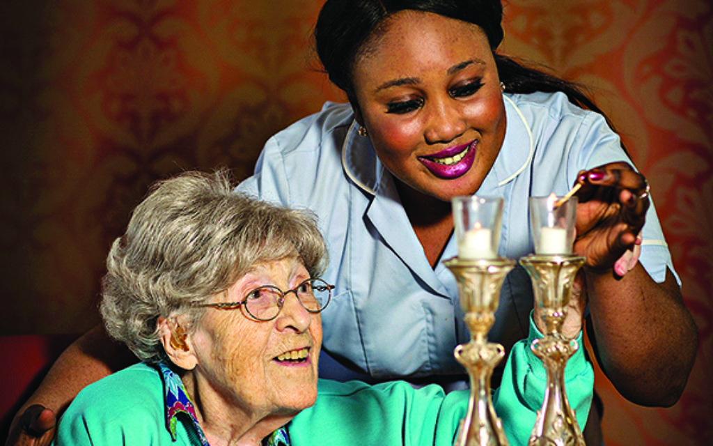 Carer Sandrine with care home resident Annie