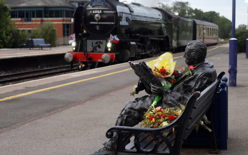 "The locomotive Tornado made a special stop in Maidenhead, Berkshire, at the statue of Sir Nicholas Winton, in honour of the man who died last week aged 106. PRESS ASSOCIATION Photo. Picture date: Wednesday July 8, 2015. The British hero who saved hundreds of children by helping them flee the Nazis before the Second World War has received a special steam-powered tribute in his home town. The locomotive Tornado made a special stop in Maidenhead, Berks, tonight in honour of Sir Nicholas Winton, who died last week aged 106. Sir Nicholas was known as ""Britain's Schindler"" for organising eight trains to carry 669 mainly Jewish children from Nazi-occupied Czechoslovakia to London in 1939, fearing they would otherwise be sent to Holocaust concentration camps. The Tornado pulled the British leg of The Winton Train, which recreated the children's journey in 2009. Tonight, decked in Union flags and Czechoslovakian flags, it stopped for four and a half minutes during a scheduled journey from London to Bristol in Maidenhead station, where there is a statue of Sir Nicholas, as a mark of respect. See PA story DEATH Winton. Photo credit should read: Steve Parsons/PA Wire"