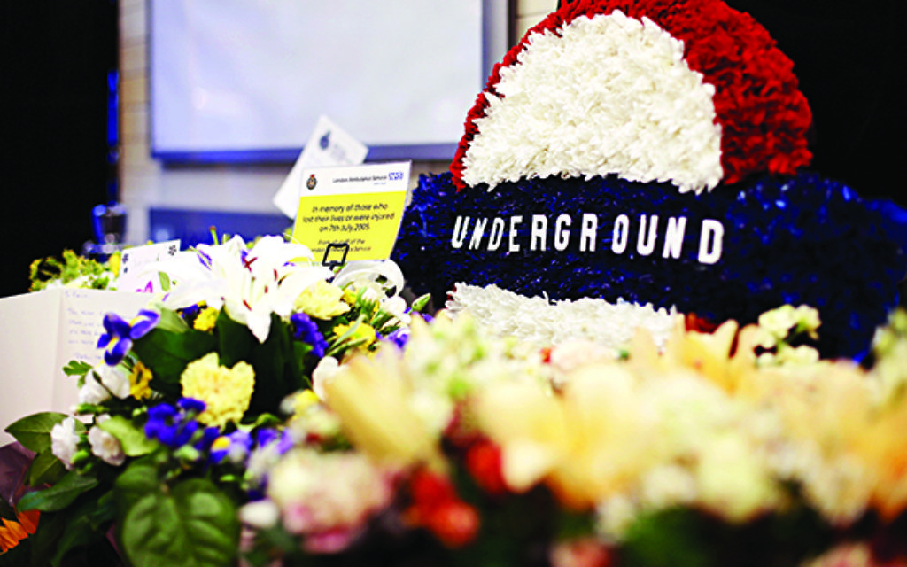Flowers left at Russell Square tube station, London, as Britain remembers the July 7 attacks amid a welter of warnings about the enduring and changing threat from terrorism a decade on. Picture date: Tuesday July 7, 2015. See PA story MEMORIAL July7. Photo credit should read: Yui Mok/PA Wire