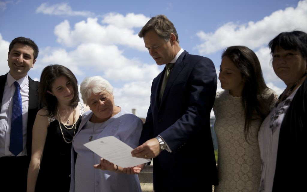 Barbara and her family, with Matthew Offord MP
