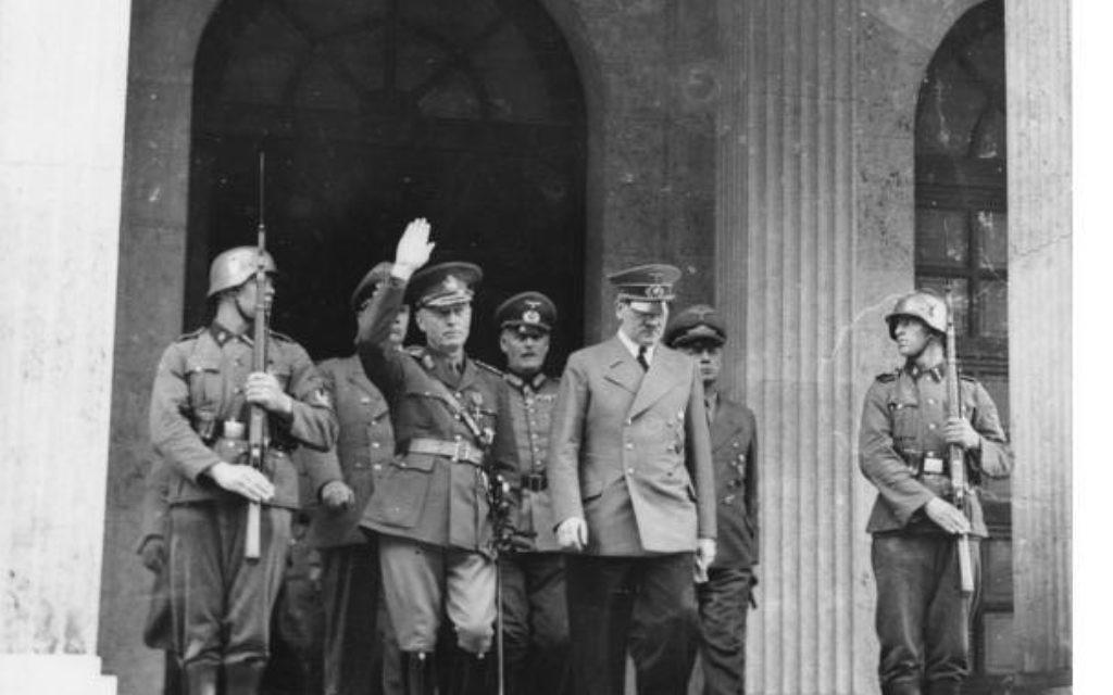Romanian dictator Ion Antonescu meeting with Adolf Hitler in June 1941.Ubz: Adolf Hitler geleitet seinen rumänischen Gast nach dem Empfang an den Kraftwagen. In der zweiten Reihe v.r. Reichsaussenminister v. Ribbentrop, daneben Generalfeldmarschall v. Keitel. 13.6.41              5903/41