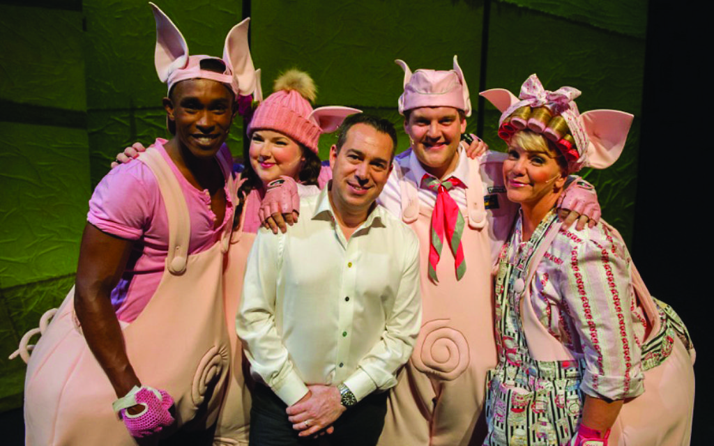 Kenny Wax on stage with cast members from his latest West End production, 3 Little Pigs