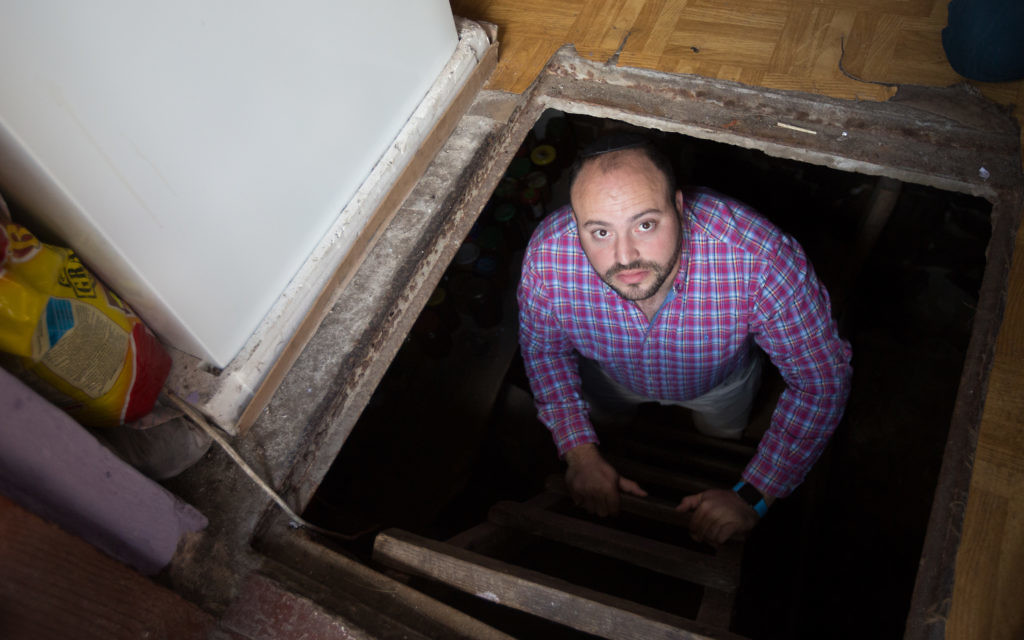 From the Depths director Jonny Daniels uncovers and films a TV spot at the site of a hiding place where Poles saved two Jewish Girls and were then killed for their actions at a local village house on June 30, 2015 in Ciepielów, Poland.   (Photo by Elan Kawesch)