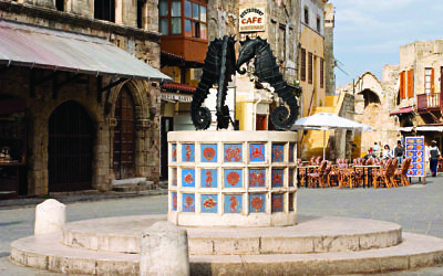 Ancient buildings and this historic fountain are among the many glimpses of a colourful past that can be seen on a visit to Rhodes