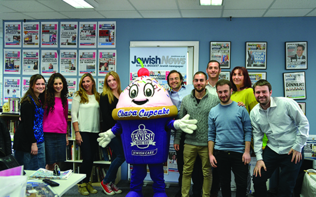 All smiles: the Jewish News team with Chava the Jewish Care cupcake.
