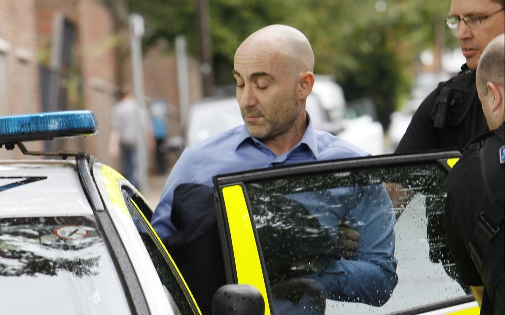 Larry Lewis, father of 25-year old Ben Lewis, was led away from St Albans Crown Court in handcuffs.