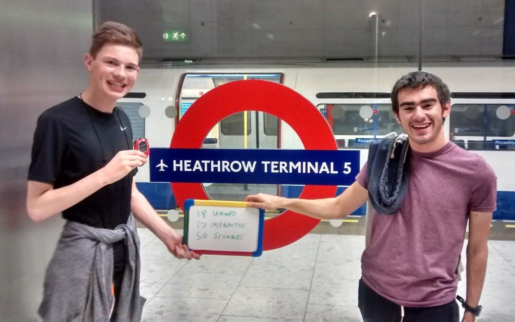 Daniel and Aaron celebrating the end of their day-long Tube journey