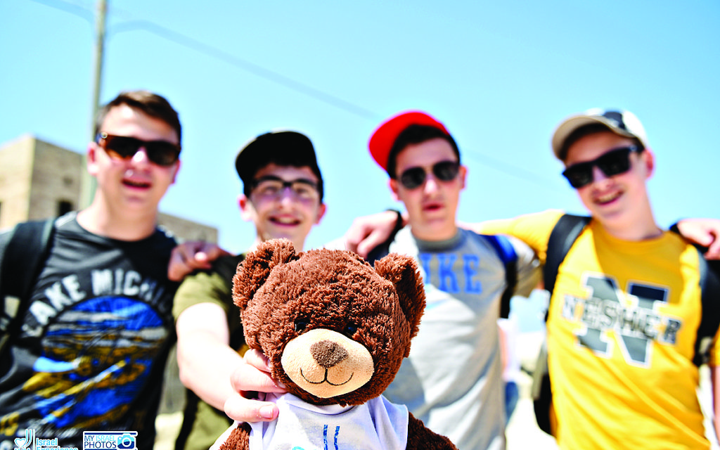 Bnei Akiva Tour 4 pose in Israel with tour member number 1,146 – or 'Ted'
