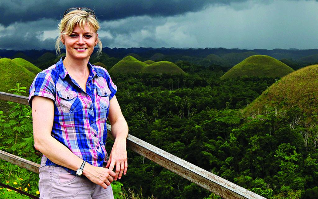 Karen Bowerman against the backdrop of the Chocolate Hills in Bohol