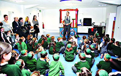 Etz Chaim pupils being entertained on the day the school officially opened in its new building
