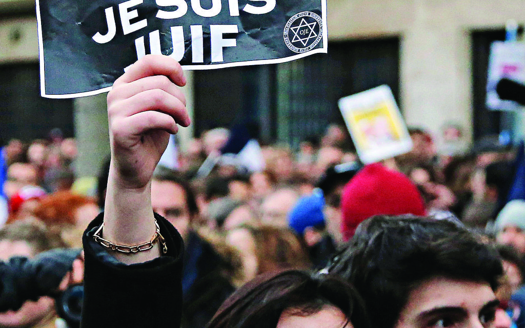 """A demonstrator holds a sign reading """"I am Charlie, I am Jewish"""" during a rally in Paris,  Jan, 2015.   (AP Photo/Francois Mori)"""