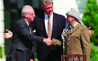 President Clinton presides over ceremonies marking the signing of the 1993 peace accord between Israel and the Palestinians on the White House lawn with Israeli Prime Minister Yitzhak Rabin, left, and PLO chairman Yasser Arafat, right. (AP Photo/Ron Edmonds)