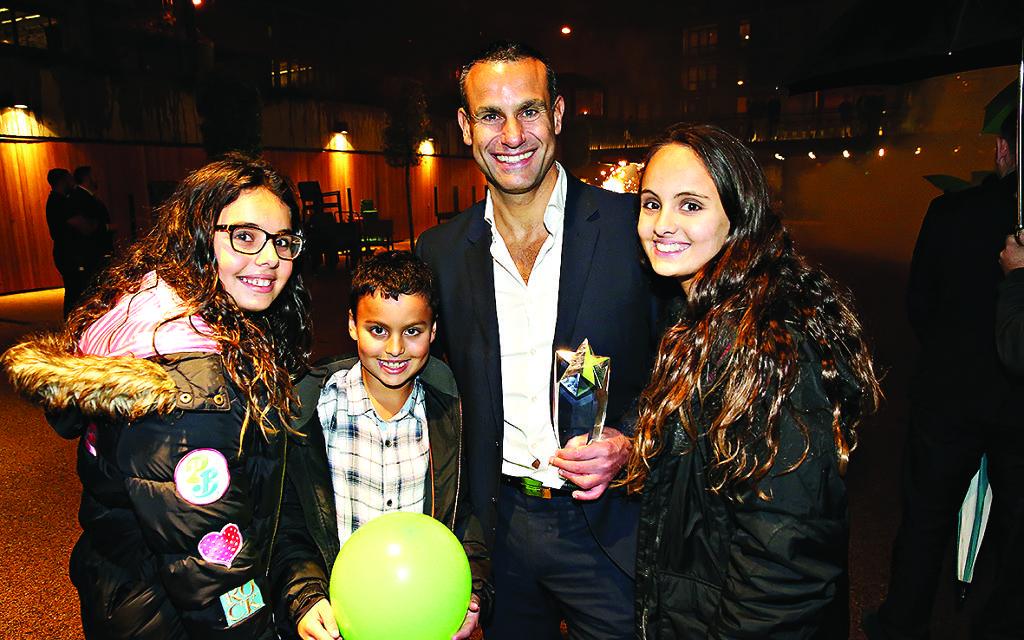 Last year's Community Hero winner Adam Cramer with his proud family