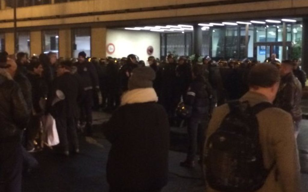 Angry protesters at the AFP building in France. (Image: David Perrotin on twitter)