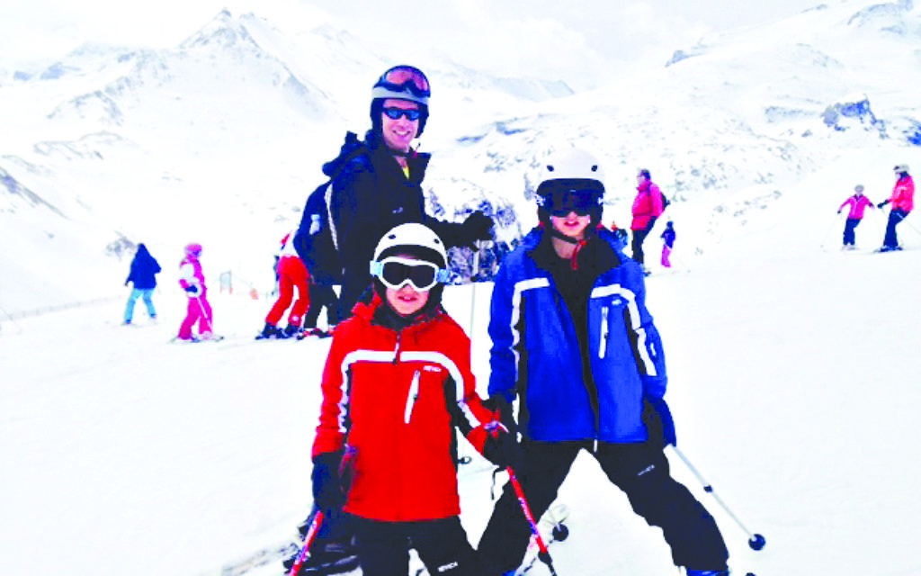 Charlotte's husband and sons on the slopes