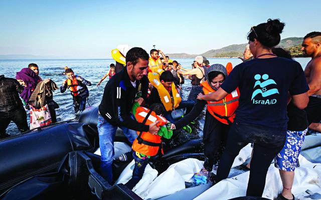 IsraAid in Greece helping refugees.