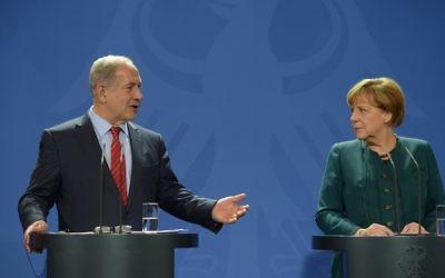 Israeli Prime Minister Benjamin Netanyahu with German chancellor Angela Merkel (Amos Ben Gershom/GPO/Israel Sun )