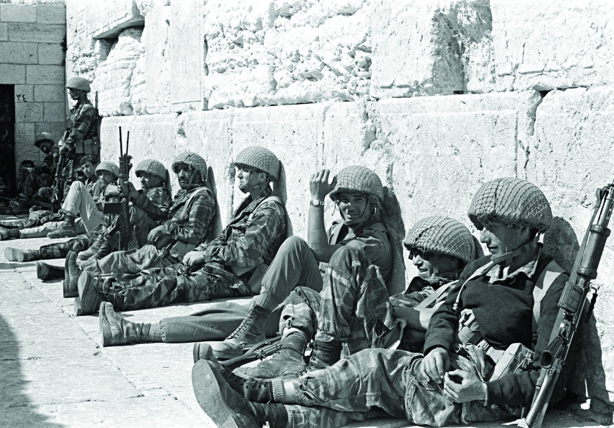 Israeli soldiers sit at the Western Wall, Judaism's holiest site, after capturing Jerusalem's Old City during the Six Day War, in June 1967. (AP Photo/Israeli Ministry of Defence,HO)