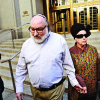 Convicted spy Jonathan Pollard and his wife (AP Photo/Mark Lennihan)