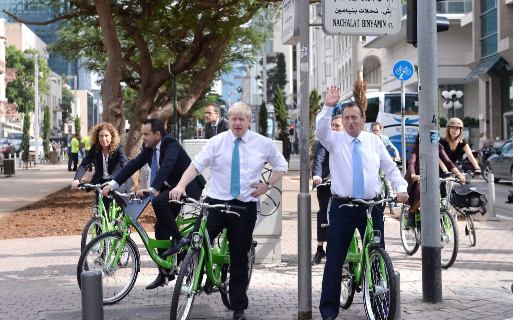 Mayor of London Boris Johnson cycles with his counterpart in Tel Aviv, Ron Huldai, in the Israeli capital where they stopped for coffee at the start of a four day trade visit to the region. PRESS ASSOCIATION Photo. Picture date: Monday November 9, 2015. See PA story POLITICS Johnson. Photo credit should read: Stefan Rousseau/PA Wire