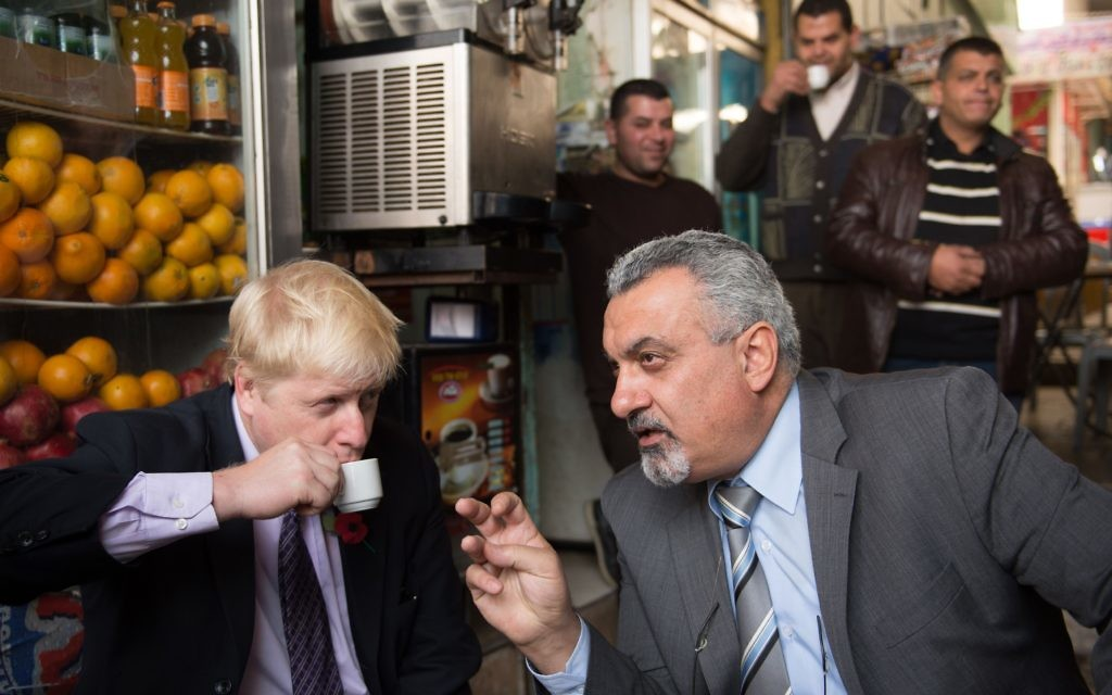 Mayor of London Boris Johnson has a coffee with adviser to the Palestinian president Ziad Al-Bandak in the Old City of Jerusalem during a tour of the historic town on the third day of his trade visit to Israel. PRESS ASSOCIATION Photo. Picture date: Tuesday November 10, 2015. See PA story POLITICS Johnson. Photo credit should read: Stefan Rousseau/PA Wire