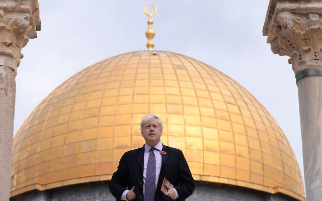Boris Johnson stands in front of the Dome of the Rock during a visit to Temple Mount/Haram al Sharif in Jerusalem, Israel. (Photo credit: Stefan Rousseau/PA Wire)