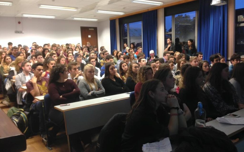 A packed room of students listening to Ari speak