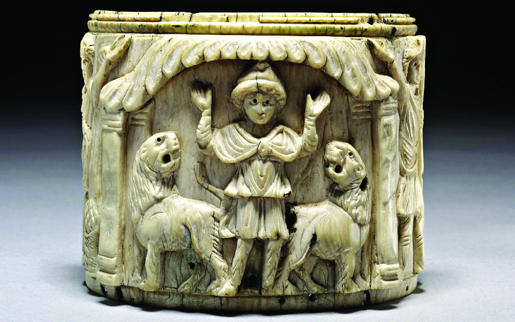 Ivory pyxis box depicting Daniel with arms raised in prayer flanked by two lions, Egypt 5th century. Picture credit: The Trustees of the British Museum