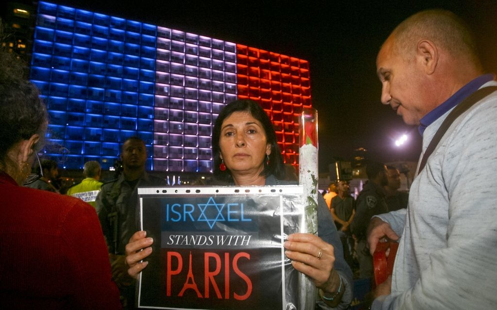 """Photo by Roni Shutzer/Israel Sun 14-11-2015 FREELANCE PHOTOGRAPHER SPECIAL %%% APPLY  Approximately 2,500 Israelis gathered in Tel Aviv's Rabin Square on Saturday evening to express solidarity with the people of France following a massive terror attack in Paris that left 129 people dead and 352 wounded. Representing Israel's governing coalition at the rally, Interior Minister Silvan Shalom told the  French Ambassador to Israel Patrick Maisonnave and other assembled dignitaries that """"Israel stands by you and we will help you. We will defeat those who want to destroy our values."""" """"We send our condolences to the French president, government and the entire French people. We will stand shoulder to shoulder with you as a nation that understands better than others what it is to be under a terror assault.""""  Israel's frail former president Shimon Peres also addressed the crowd, as did Israel's opposition leader Isaac Herzog and French ambassador Patrick Maisonnave. All the speakers emphasized Israel and France's common dedication to freedom and democratic values, and the phrase """"vive la liberté"""" rang out repeatedly. The gathering concluded with the singing of the French and Israeli national anthems, with many in the crowd singing along.    ???? ?????? ?? ??????? ?????? ????? ????? ??????? ???? (???) ????? ????. ????? ?????? ?? ????-??? ???? ????? ??? ????????? ??????? ???? ?????? ?? ??????? ?????? ??????????? ?? ????. ???? ?????? ????? ????? ??? ??? ?????: """"????? ???????, ???? ??? ?? ??? ???? ?????? ????. ??????? - ???????""""."""