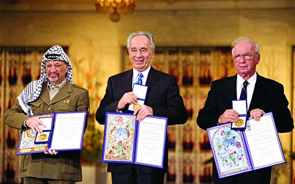 Yasser Arafat, Shimon Peres and Yitzhak Rabin with their Nobel Peace prizes.   Image: Sa'ar Ya'acov for the Israel Government Press Office