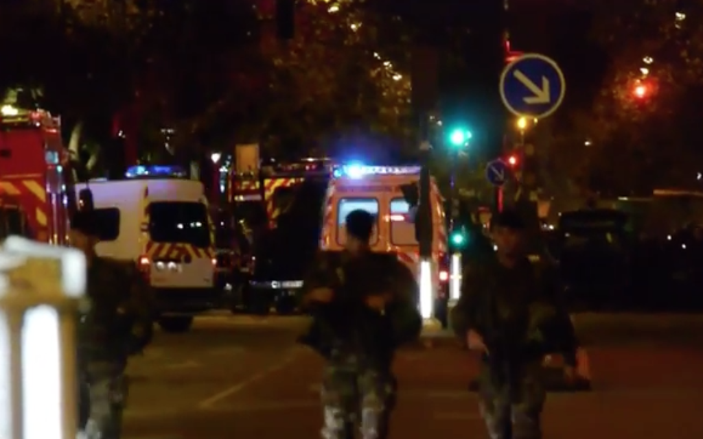 Paris was dominated by police cars and  as it descended into a state of emergency