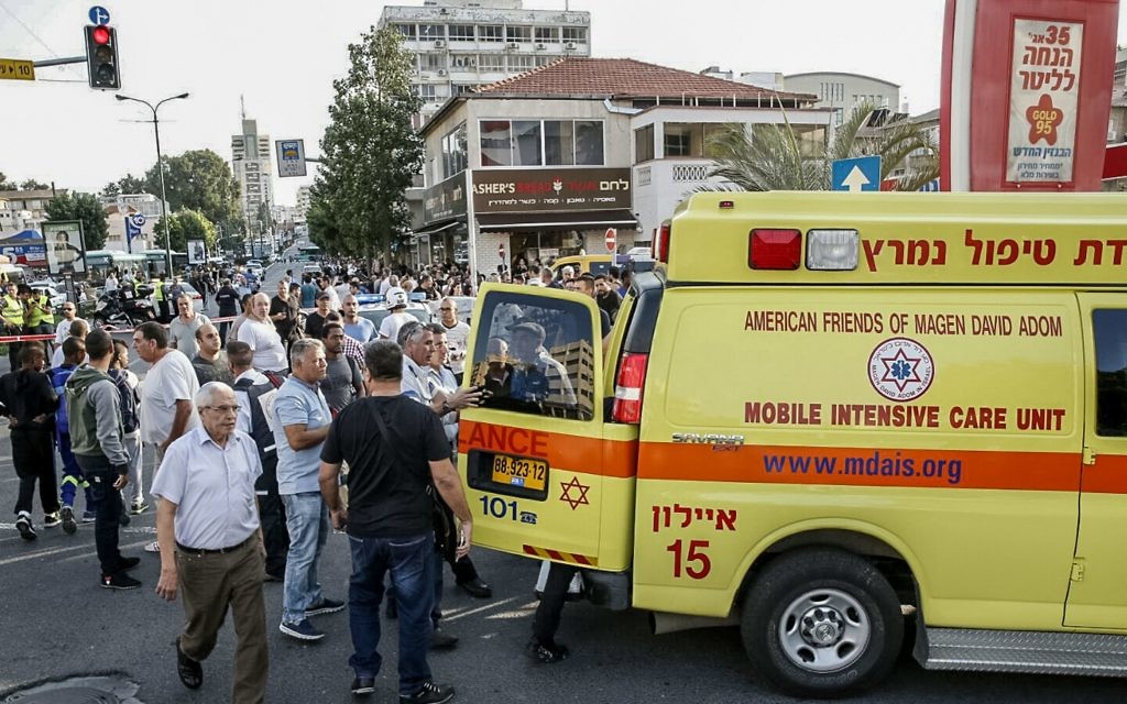 Scene after a terrorist attack in which three people were stabbed. The attack began on a bus and continued into the street in Rishon Lezion. (Photo by Eliran Avital/MDA Spokesman/Israel Sun 2-11-15)