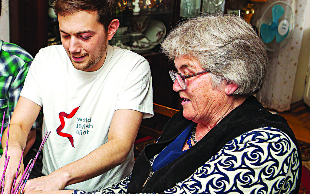Richard Verber working with a local resident during A World Jewish Relief project in Ukraine