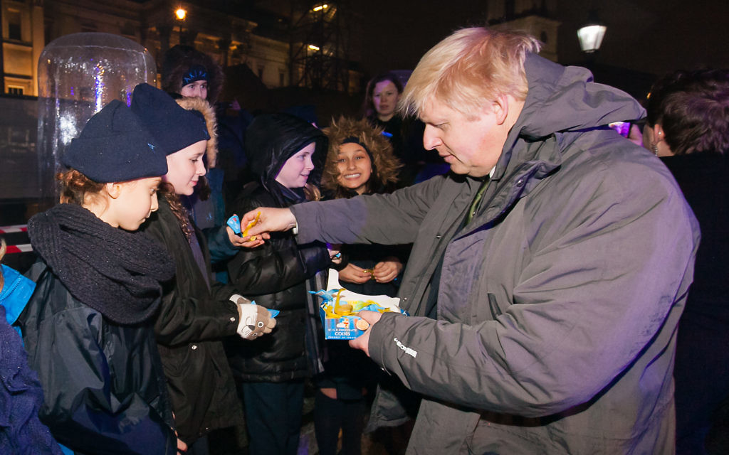 Boris Johnson hands out sweets to youngsters at Chanukah In The Square.