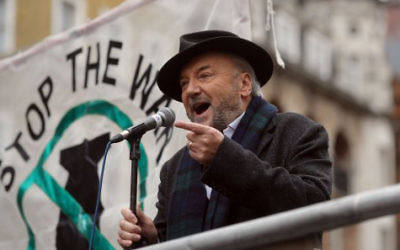 George Galloway MP speaks to protesters at Whitehall in London during a demonstration organised by Stop the War Coalition against proposed bombing of the Islamic State in Syria.