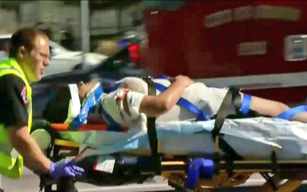 Medics attend the scene of the shooting