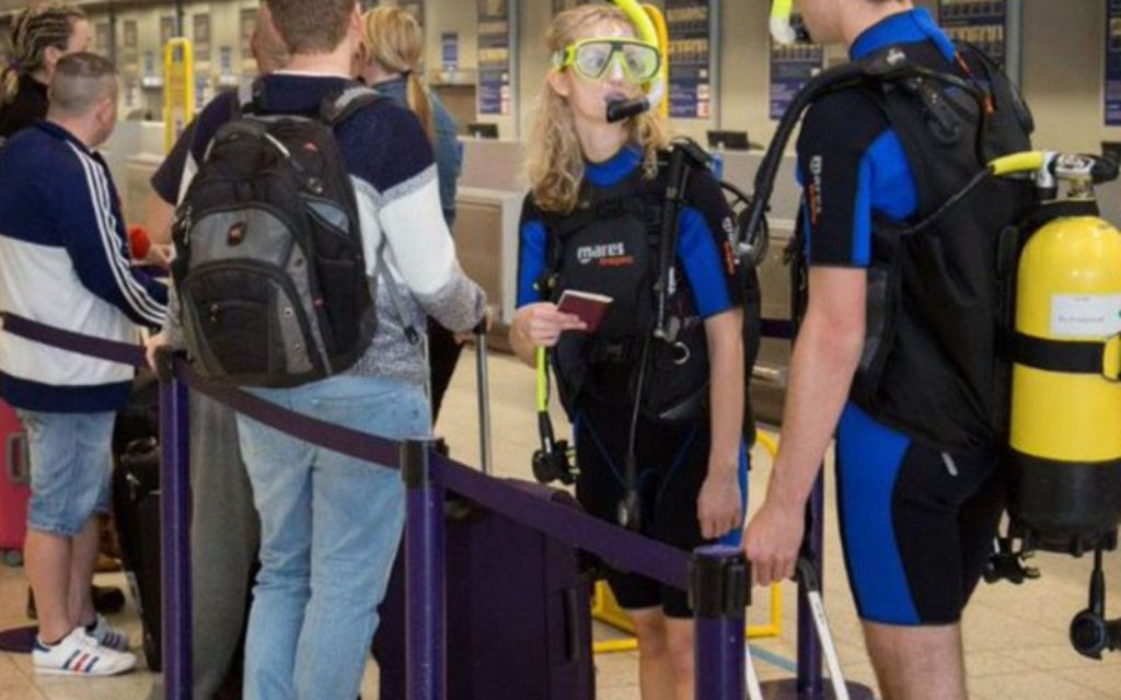 Next stop Eilat! Scuba divers check in at Monarch's desk at Luton Airport for the airlines inaugural flight to Ovda last week.