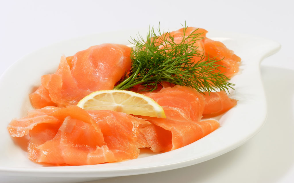 Smoked salmon on dishware with bright background