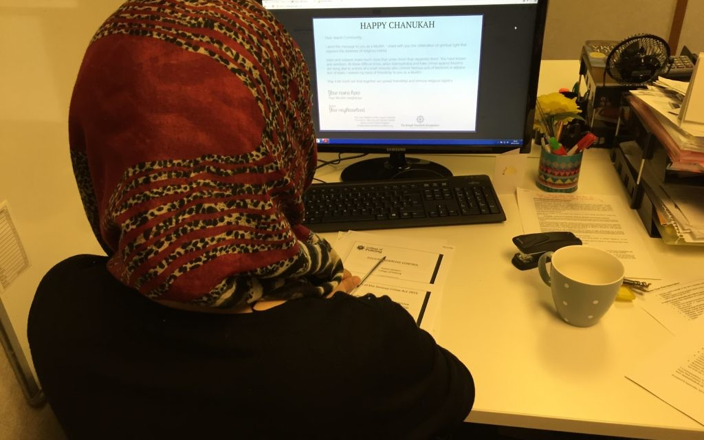A Muslim woman reading the card online