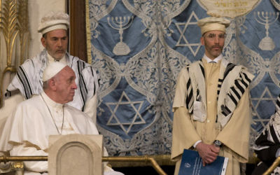 Pope Francis sits during his visit to the Great Synagogue of Rome, Sunday, Jan. 17, 2016. Pope Francis made his first visit to a synagogue as pope Sunday, greeting Rome's Jewish community in their house of worship as his two predecessors did in a show interfaith friendship at a time of religiously-inspired violence around the globe. (AP Photo/Alessandra Tarantino)