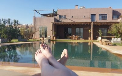 Relaxing by the pool at Fellah Hotel