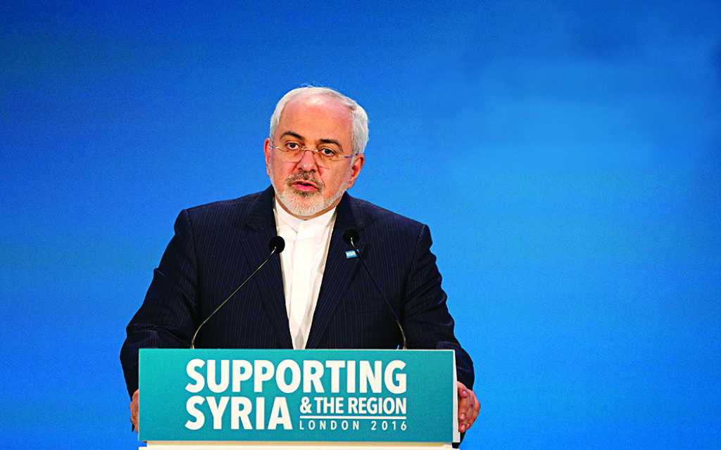 Iranian Foreign Minister Mohammad Javad Zarif makes a pledge during the second co-host chaired thematic pledging session for jobs and economic development during the 'Supporting Syria and the Region' conference at the Queen Elizabeth II Conference Centre in London, Thursday, Feb. 4, 2016. Leaders and diplomats around the world are meeting in London Thursday and pledging some billions of dollars to help millions of Syrian people displaced by war, and try to slow the chaotic exodus of refugees into Europe. (AP Photo/Matt Dunham, Pool)