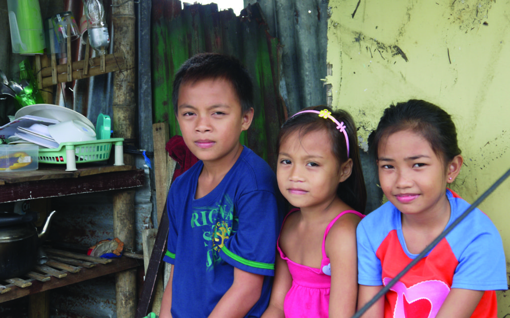 Children in a temporary shelter at Taclabon.